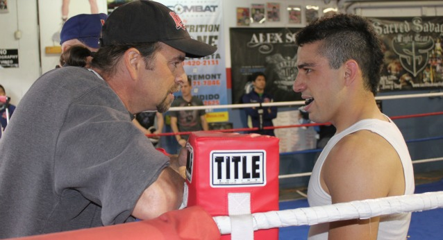 Well respected boxing trainer, Tom DiFrancesco, passes along some last minute advice to his boxer, Scott Torres (R). Photo: Jim Wyatt