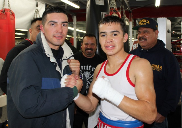 At the conclusion of Bout #24, Genaro Gamez of United Boxing is congratualted by pro boxer Pablo Armenta.