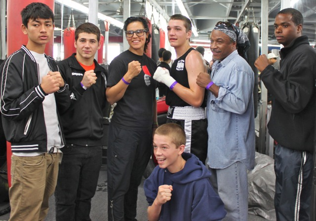 Members of the Old School Boxing Team (L to R) Boxers Abdullah Nematjanov, Hussein Fakhreddine, coach Kalina , boxer Nicholas Carrico, head coach Ernie Johnson, boxers Terence Edwards and kneeling Tyler Herberger pose for a photo after Nicholas Carrico's win in the 165 pound Finals.