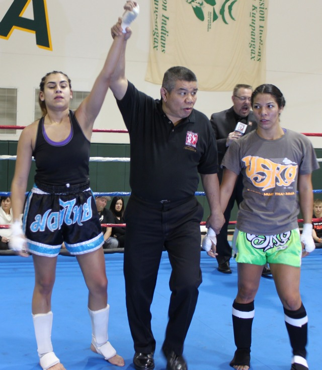 Teresa garcia of Valdez Muy Thai has her arm raised in victory after defeating Evaonne aguilar of USKO Riverside.