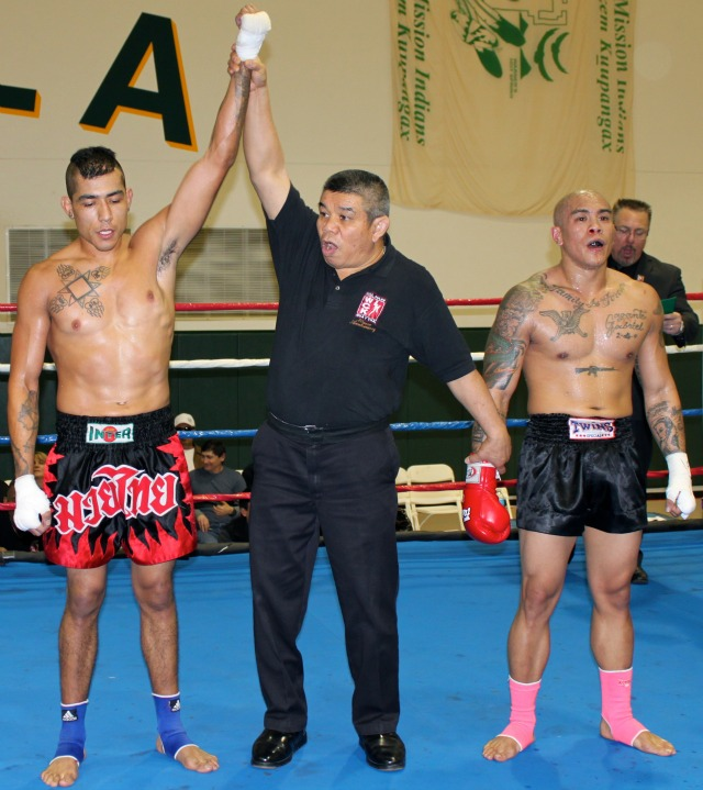 At the conclusion of Bout #7, Bradly Guachino (L) has his arm raised in victory after defeating Andrew Gabriel