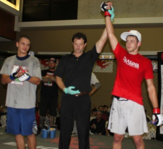 Bout #10 winner Tyler Sidders of the Arena has his arm raised in victory after defeating Ritchie Rodarte