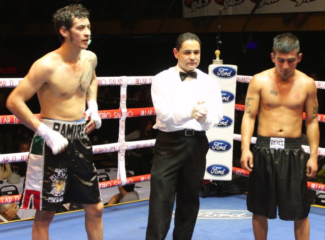 At the conclusion of Bout #1, Daniel Ramirez, the eventual winner, and Antonio Villa await the judges decision for Bout #1 of the Mayen Promotions Boxing Show on Wednesday evening, January 30, 2013 at the Salon Las Pulgas Concert Hall in Tijuana.