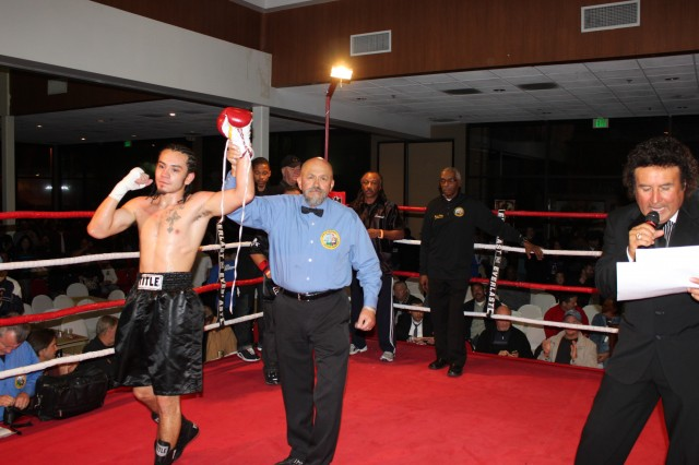 Emmanuel Robles has his arm raised in victory on Thursday evening, February 21, 2013 in the Main Ballroom of the Four Points by Sheraton Hotel in San Diego by referee Jose Cobian after easily defeating Adolfo Landeros to remain undefeated at 7-0-1.