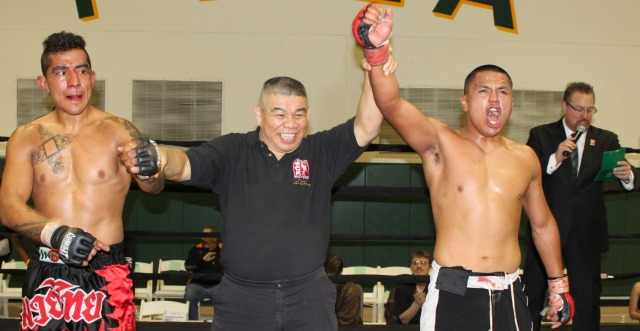 On Saturday evening in Bout #9, an MMA bout, February 23, 2013, Matt Arriola (R) of the Adrenaline Gym in San Bernardino, CA had his arm  raised in victory after defeating Brad Guachino of the host gym, Pala Recreation Center.