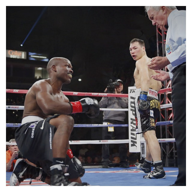 This photo by Chris Farina of Top Rank, Inc. shows that all important moment of truth - the decision to rule either a slip or a knockdown and referee Pat Russell made the decision that it was only an off balance slip.