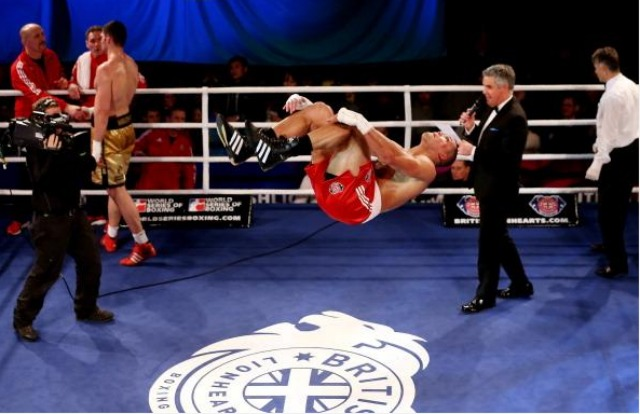 Who does this? Apparently Joe Joyce. Here we see him celebrating his victory over Filip Hrgovic with a back flip during their World Series of Boxing contest, February 7, 2013 in London, England.