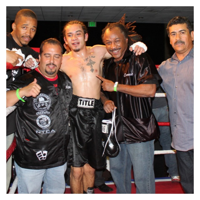 "Emmanuel Robles poses for a photo with his support group, (l to r) assistant trainer, Ernie ""Silky"" Johnson, cutman , head trainer Ernest Johnson, and promoter/matchmaker Jorge Marron."