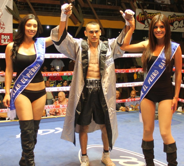 Jose Luis Ramirez Jr. has his arms raised by the lovely ring card girls after defeating Michelle Canete.
