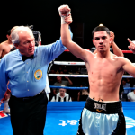 Referee Pat Russell raises Randy Caballero's arm after he defended his WBO NABO bantamweight title against Manuel Roman on August 24, 2012 at the Fantasy Springs Casino, Indio, CA.
