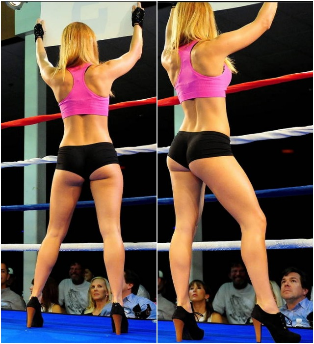 If you look down at the bottom of these two photos, there are two attractive ladies in the audience looking up at the ring card girl. Can you guess what they're thinking as they check out the competition? Perhaps the brunette is thinking, 'First thing Monday morning, I'm going restart my workouts.' The blonde seems more intense, 'Now I know why my husband comes to these shows.'