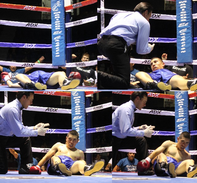 Desperate to get back to his feet, the still groggy Jose Toribio tried his best but failed to beat the referee's 10 count. All photos; Jim Wyatt