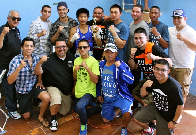 The House of Boxing's boxing team poses for a photo with their coaches Carlos Barragan Sr., Carlos Barragan Jr. and pro-fighter Israel Arellano at Saturday's show in Ocean Beach.