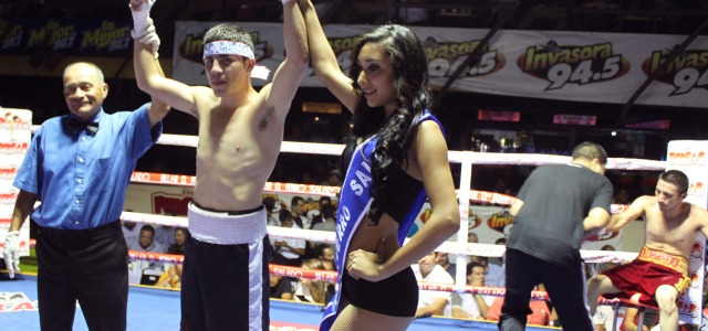"Jose Galvez has his arm raised in victory by the lovely ring card girl  and referee Juan Morales Lee and he defeated Leobardo ""Taliban"" Laguna."