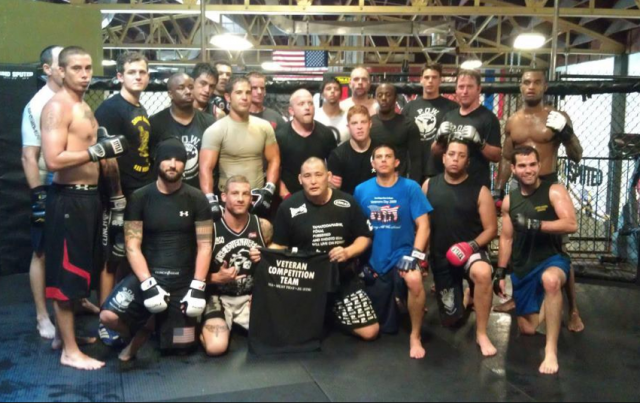 Todd Vance and his POW Fight Team pose for a photo.