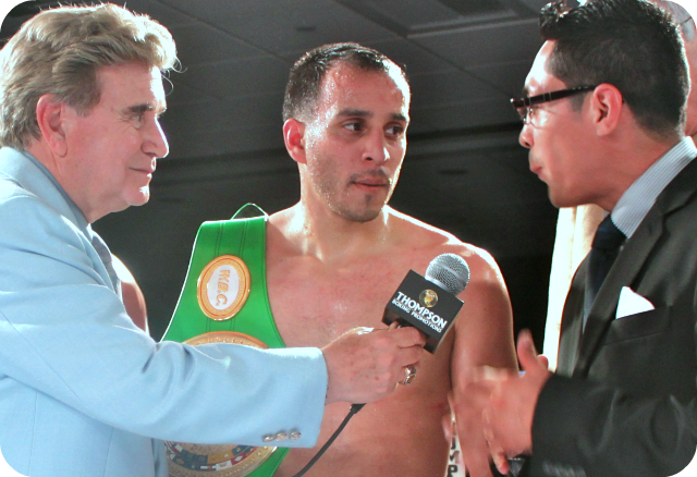 """The former super bantamweight champion of the world, now Gym owner and ringside commentator, Israel Vasquez (r) interviews Chris """"Marvelous"""" Martin of Chula Vista, CA (c) after his TKO win over Raul """"Bule"""" Hidalgo of Casas Grandes, Chihuahua, Mexico. All photos: Jim Wyatt"""