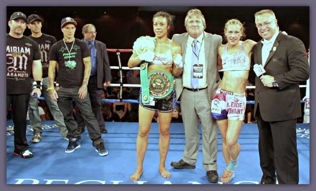 At the conclusion of their five round bout for the WBC Muay Thai Women's Lightweight World Title, Miriam Nakamoto, the winner and still champion, poses for photos with (r to l) Chris Gregory, the show's MC, her opponent, Aleide Lawant of The Netherlands, the show's promoter Dennis Warner, CEO of In Sync Promotions.Off to the left sits her support group.