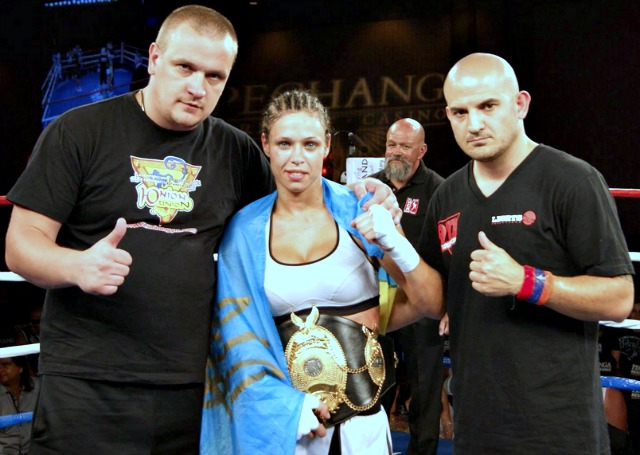 After her victory over Emily Bearden, Lena Ovchynnikova was joined by her coaches (l to r) Viktor Lazurko and George Jay Bastmajyan.