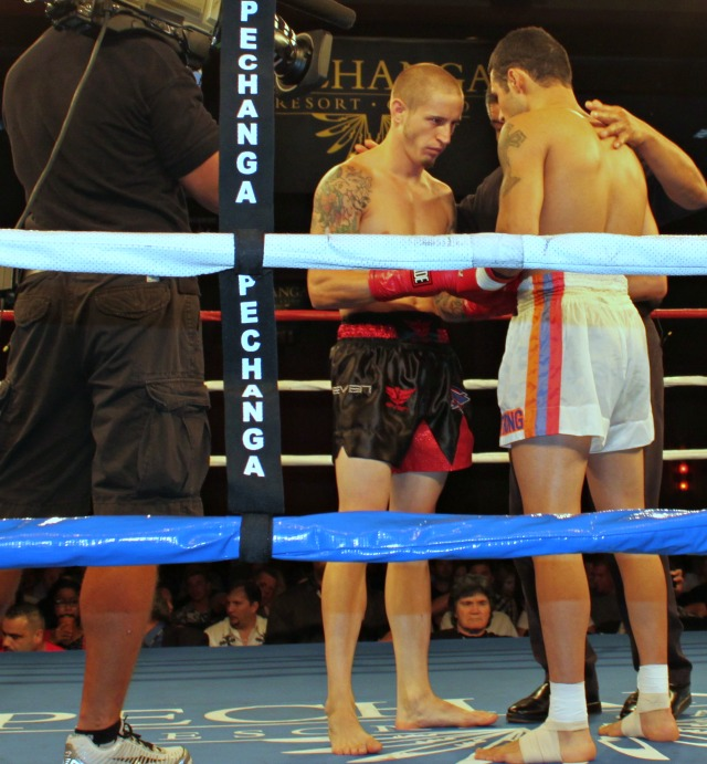 Prior to their scheduled five round WBC Featherweight bout, Adam Rothweiler of San Bernardino, CA and Levon Sarkysan of Glendale, CA meet in the center of the ring with referee Vichai Supkitpol.