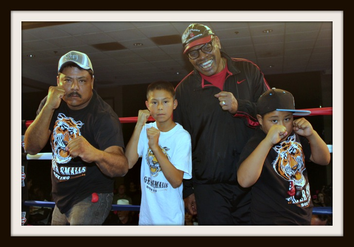 Two young boxers with their dad