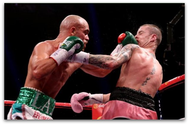 How about a left hook sandwich? Raymundo Beltran (r) has Ricky Burns (l) eat some of his glove in during their WBO World Lightweight Title bout on September 7, 2013 in Glasgow, Scotland. Photo: Scott Heavey/Getty Images