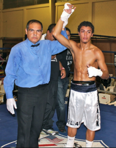 Carlos Carlson (r) has his arm raised in victory by referee Juan Jose Ramirez after defeating Francisco Javier Lopez at the Gimnasio Eufrasio Santana in Tecate, B. C., Mexico on On October 27, 2012.