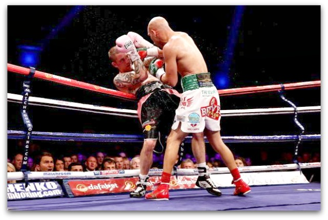 Ray Beltran has Ricky Burns backed up against the ropes. Photo: Scott Heavey/Getty Images