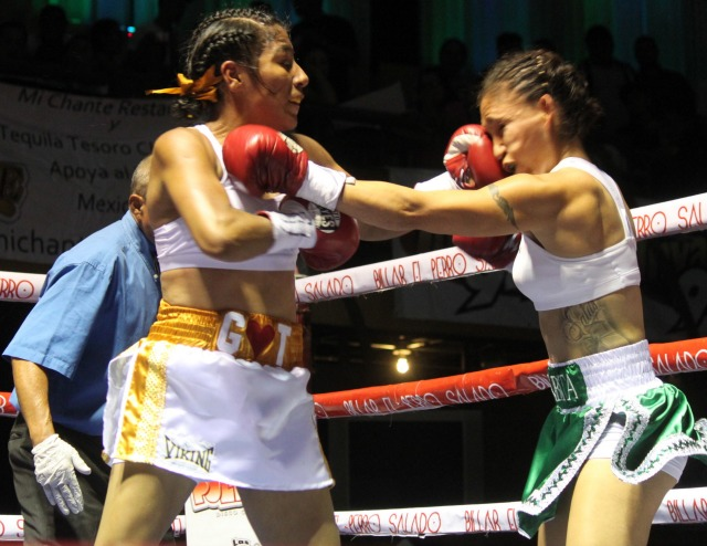 kenia Enriquez unloads a solid left hook on her opponent