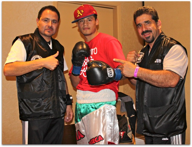 """In the dressing area before his bout with Levan """"the Wolf"""" Ghvamichava of Poti, Georgia, Victor """"Sina"""" Fonseca (center) poses for a photo with his coaches/co-managers Luis Lorenzo (r) and Gabriel Quinones (l). Photo: Jim Wyatt"""