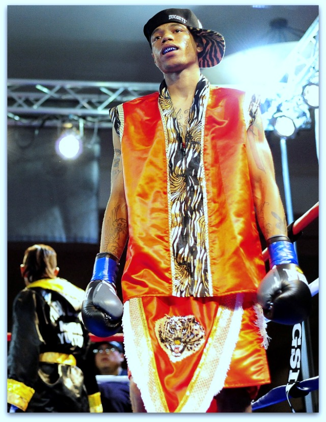 """The five action photos above plus this photo of Prince """"Tiger"""" Smalls making his entrance into the ring were taken by sports photographer Paul Gallegos."""