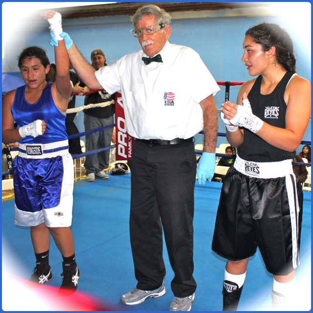 At the conclusion of Bout #9, it was Jasmine Mosqueda (l) having her arm raised in victory by referee Will White and she defeat Jasmine Hernandez (r).