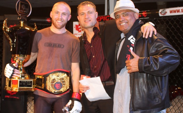 At the conclusion of Epic Fighting Fighting  21, Jason Stewart (center) posed for several photos with David Fabian, the new Lightweight Champion and Stewart's proud father. Photo: Jim Wyatt