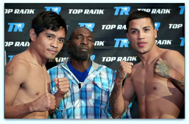 At their official weigh-in on Friday, Rolly Lunas (l) weighing in at 120½ lbs. and Chris Avalos weighing at 122 lbs. (r) pose for photos.