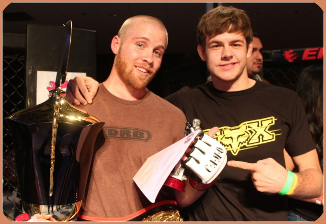 David Fabian, the new Lightweight Champion is congratulated by Tyler Sidders the former lightweight champion who gave up his belt to turn pro.