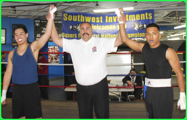 At the conclusion of the bout, Armando Tovar (r) over Eric Nguyen (l) have their arms raised by referee Hondo Fontan.