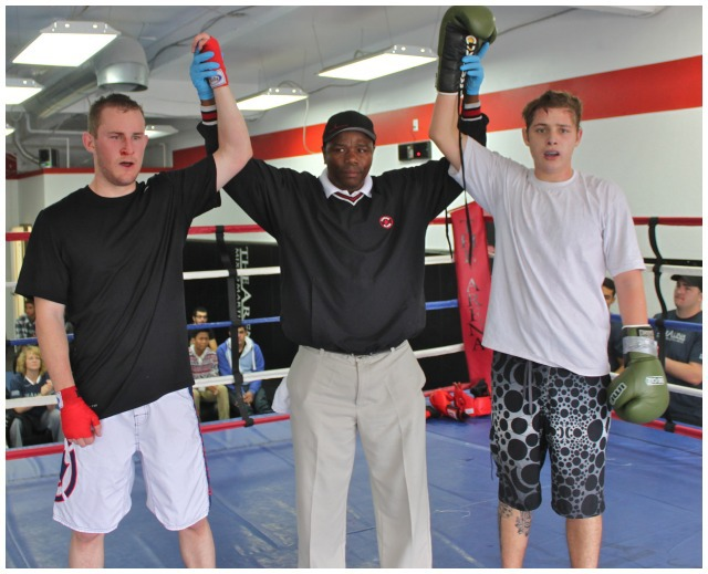 Bout #1, a boxing match featuring Rick Norton (l) going up against Theo Shwarz (r) was refereed by former pro-boxer, now trainer, Lucky Nhlengethwa of The Arena.
