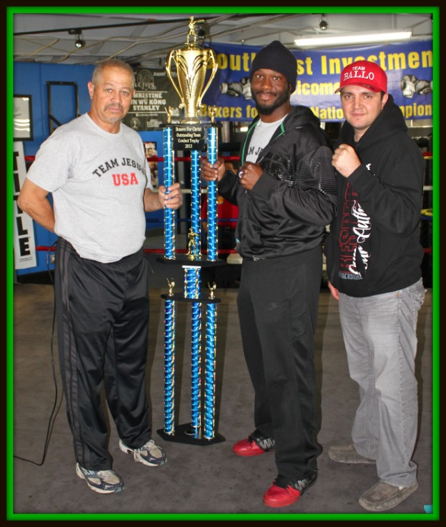 On behalf of the Undisputed Boxing Team, their coach, Berlin Kerney IV, accepts the 2013 Boxers for Christ Outstanding Team Conduct Trophy.