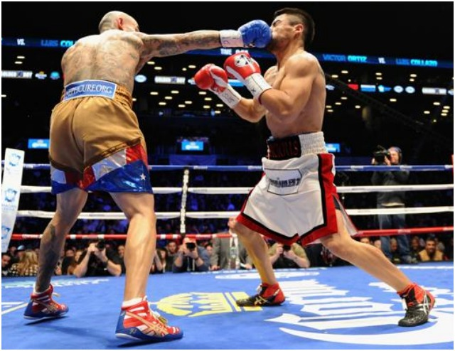 Luis Collazo celebrates his knock out victory of Victor Ortiz after their WBA International Welterweight title bout at the Barclays Center. Photo: Maddie Meyer/Getty Images