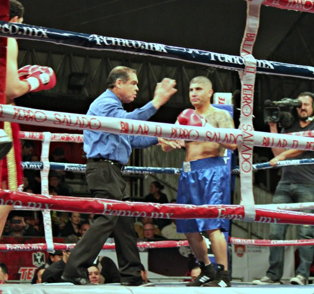 Referee Juan Jose Ramirez is shown giving Omar Aizpuro the 8-count.