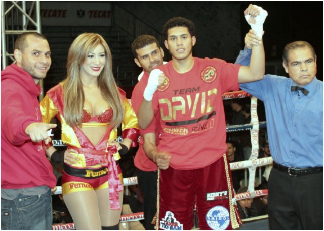 Bout #2 winner David Benavidez has his arm raised in victory by veteran referee Juan Jose Ramirez.