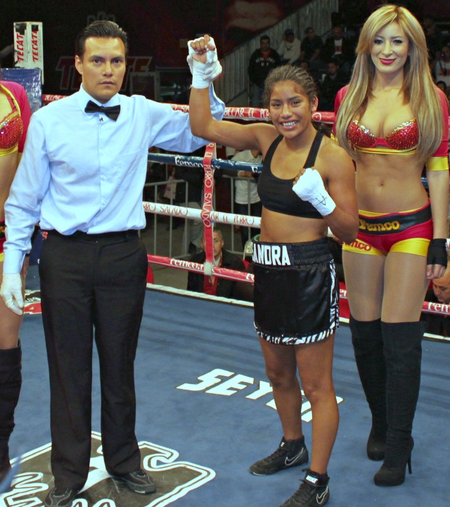 Sandra Robles (c) has her arm raised in victory by referee Cristian Curiel. Photo: Jim Wyatt