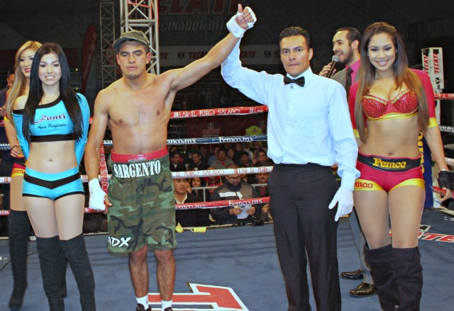 At the conclusion of Bout #7, Dario Garibay (l) has his arm raised in victory by referee Cristian Curiel.