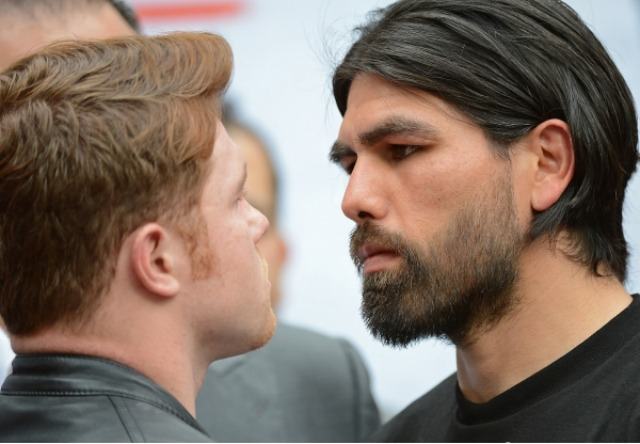 Saul Canelo Alvarez (l) and Alfredo Angulo (r) face off during their press conference in Los Angeles for their upcoming fight Saturday, March 8, 2014 in Las Vegas.