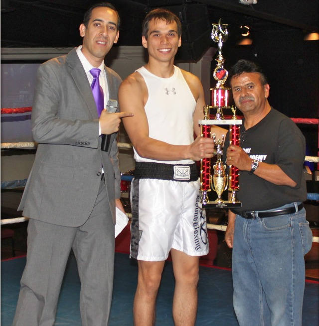 "Boxer of the Show award was presented to Matthew ""Good Night"" Knight (c) of the Bound Boxing Academy, Chula Vista, CA. by the show's promoter/organizer Junebug Mendivil and MC Pablo Flores (l)."