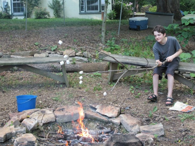 young Jim Wyatt toasting marshmallows