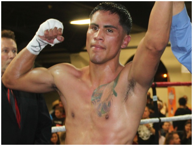 "Jorge ""Tito"" Ruiz has his arm raised in victory and he defeated Oscar Venegas in Bout #5. Photo: Jim Wyatt"