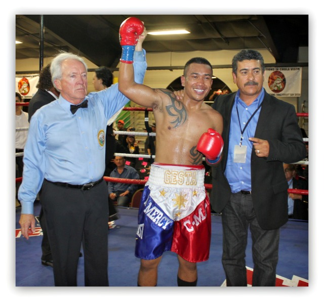 At the conclusion of the bout, referee Pat Russell raises Mercito Gesta's arm while promoter/matchmaker Jorge Marron (r) Photos: Jim Wyatt