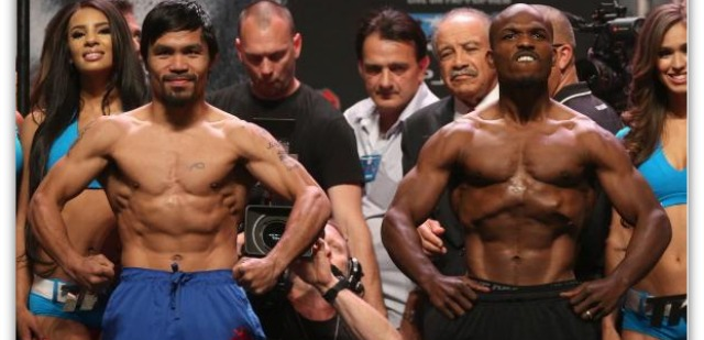 April 11, 2014, at the MGM Grand Garden Arena in Las Vegas, Nevada, Manny Pacquiao (l) and Timothy Bradley (r) flexed their muscles at the official weigh-ins for the following night's WBO World Welterweight Title bout. Photo: Jeff Gross/Getty Images