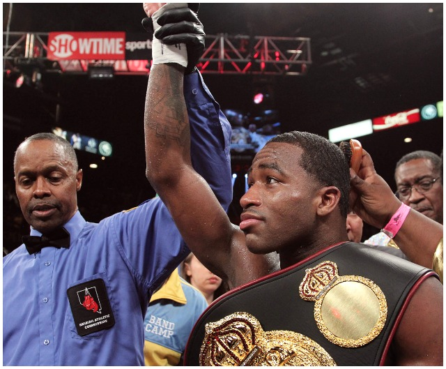 At the conclusion of his bout versus Carlos Molina, Adrien Broner has his arm raised in victory by referee Kenny Bayless.