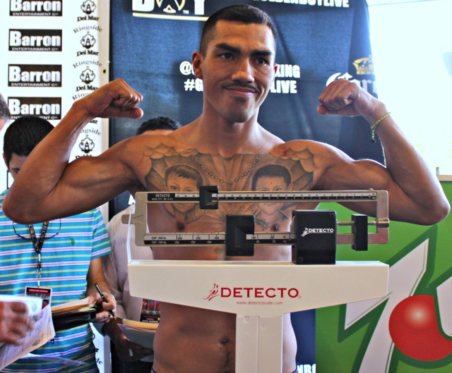 "The much celebrated Martin ""El Brochas""  Honorio takes his turn on the scale. Antonio Orozco weighed-in at 141 pounds while Martin Honorio weighed 140 pounds."